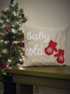 """This linen """"Baby it's cold outside"""" pillow cover is sure to add texture, dimension and interest to your Christmas decor. It is available in a natural colored linen with the design in Country Red. This"""