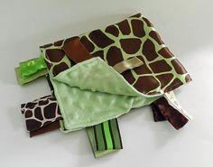 Silky Satin Green Giraffe and Minky Mint Dot Ribbon Tab Sensory Blanket for Babies. Has Ribbon Tags for play and chewing.