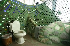 earthship powder room, love the bottle walls
