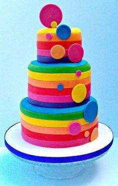 Rainbow cake via Lisa franks fb page.  I think it's mostly fondant over layer cake