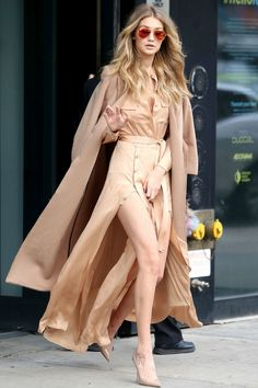 Gigi Hadid looked so stylish in a camel coat layered over a nude skirt and top.