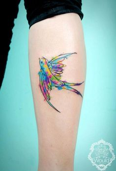 Watercolour tattoos look fantastic on some skin shades... this one by Candelaria Carballo.