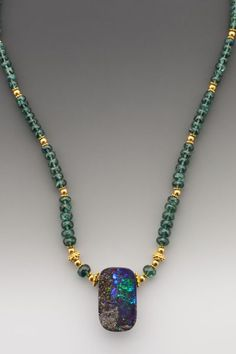 Australian</i> boulder opal -- with deep navy blues layered over a range of layered greens -- on deep bottle-green faceted semi-transparent apatite & 18K.