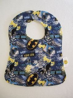 DC Comics  Batman  Snap Baby Bib for a baby boy. This would be cute for the birthday boy to wear. Or party favor for the babies.