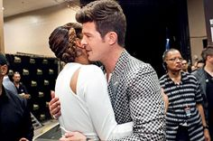R singers Monica and Robin Thicke hug it out.