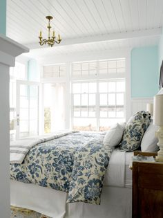 Blue bedroom, love the transom windows and beadboard ceiling.