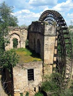 "destroyed-and-abandoned: ""An old, overgrown Albolafia Mill and water wheel in Cordoba, Spain. Photo by Chase Taylor. ethan_kahn: ""This mill is situated next to the Roman Bridge on the northern bank. Abandoned Buildings, Abandoned Mansions, Old Buildings, Abandoned Places, Beautiful Buildings, Beautiful Places, Old Barns, Haunted Places, Le Moulin"