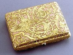 Fabergé.A two-color gold cigarette-case in the Renaissance taste, the pink matte gold body chased with yellow gold cartouche, scrolling acanthus foliage and mythical birds, cabochon sapphire pushpiece - signed with Imperial Warrant mark, initials of workmaster Oskar Pihl, assay marks for Moscow before 1899 and Moscow 1890, unrecorded assay master's initials AA, inventory no. 4803, length 3 1/2 inches (9 cm)