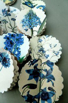Ho fatto questo adorabile ghirlanda/mobile utilizzando alcune splendide immagini di fiori di campo blu Shabby Vintage creati da un artista Etsy, carta