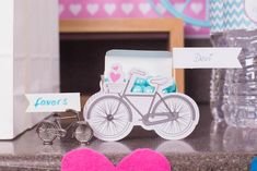 Bicycle place card holders and vintage-inspired bicycle favor boxes added a whimsical touch to the party. | Bicycle Place Card Holder and Bicycle Favor Box by @kateaspen via @apartystudio