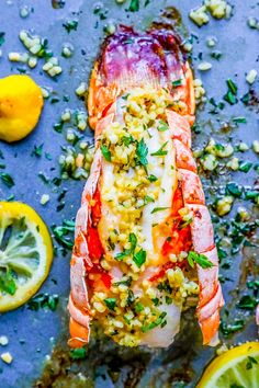 The most delicious garlic butter lobster tail dinner ever - so easy and delicious for a restaurant quality dinner at home!
