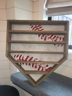 Reclaimed wood baseball rack for all your slugger's home run balls! Boards are slightly slanted to keep balls from rolling off once hung, however wood is reclaimed and natural imperfections can impact ball placement. No indentations.