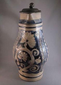 An impressive three quart baluster shaped stoneware pottery beer pitcher made in Haddonfield, NJ by Carl Wingender between 1820 and 1850. Jug has a hinged pewter lid and is decorated with an incised floral motif filled in with cobalt blue slip.