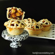 Easy Individual Apple Pies....They are overstuffed with a caramel-y, cinnamon apple filling, and the crust is so buttery and delicious. And, bonus! You get to eat the whole pie. All.By.Yourself.