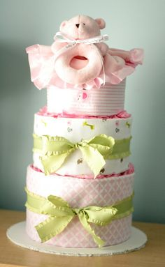 Blanket-Wrapped Diaper Cake.  You can purchase our gender neutral Sage Creek Organics blanket here: http://www.sagecreekorganics.com/detail.aspx?ID=1442 for a great diaper cake!