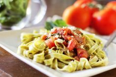 Fettucine with spinach, tomatoes, and pesto.