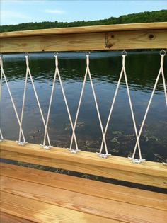 Close up of deck railing with cleats and rope.