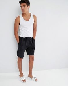 Get this Calvin Klein s pyjama bottom now! Click for more details.  Worldwide shipping. Calvin Klein Woven Lounge Shorts in Regular Fit -  Black  Shorts by ... 3ff47343e6a2