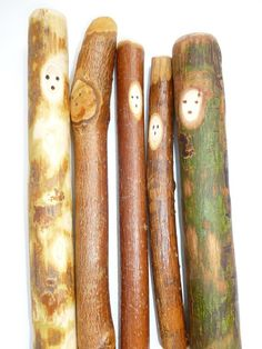 Sand down and draw faces on twigs, then leave them in the woods for people to stumble upon.