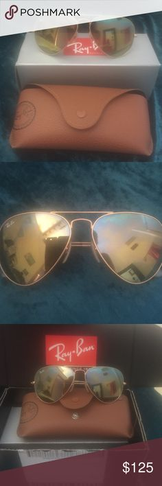 ☀️Gold mirrored aviator Ray-Ban sunglasses ☀️☀Ray Ban Mirrored gold aviator☀️☀️sunglasses. 100% Authentic  sunglasses  from the Official Ray Ban website.  Have been worn. Bought new pair with the flash mirror design. Size 58 worn off and on. Excellent condition no flaws period.  Love the mirrored aviators the size fits face perfect. Are considered a unisex design get for yourself or that special father in your life.  Case, cloth cleaner and all Ray Ban literature included. Can ship in…