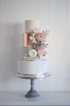 Modern rose gold marble wedding cake with sugar flowers and succulents #poppypickeringcakes #marble #rosegold #succulents