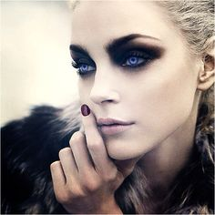 Makeup...certainly too stylized for an everyday look, but it would be pretty awesome for Halloween.
