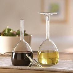 Wine Glass Oil & Vinegar Set  Wine glasses upside down and used as oil and vinegar cruets. $45