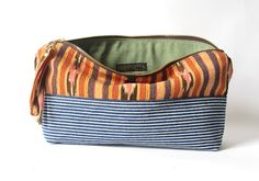 Items similar to Handmade Zipper Pouch: striped denim and hand woven ikat fabric on Etsy Ikat Fabric, Zipper Pouch, Color Schemes, Hand Weaving, Sewing Patterns, Textiles, Purses, Trending Outfits, My Style