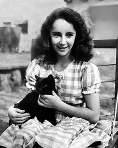 "In February of 1945, LIFE magazine ran a story on child actresses - included was this image of a 13-year-old Elizabeth Taylor with her black cat named Jill. ""She love animals and out-of-doors."" (Peter Stackpole—The LIFE Picture Collection/Getty Images) #thisweekinLIFE #LIFElegends"