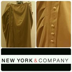 Womens dress skirt Plus size pencil skirt with some spandex stretch. Khaki in color. Decorative pleats & buttons on one side. 1 button missing as shown. Priced accordingly.  Great condition. Worn twice. 23 inches long. New York & Company Skirts