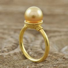 Solid genuine 22K yellow GOLD ring set with a genuine round golden South Sea Pearl and decorated with Bali granulation work $1850