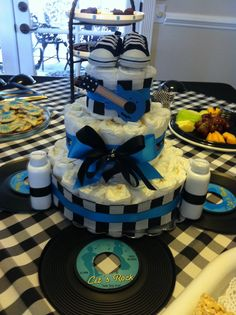 Rock star themed baby shower! This diaper cake was the center piece!!
