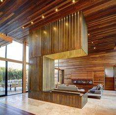 Sam's Creek : Salas de estar modernas por Bates Masi Architects