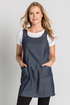 Versatil jumper dress with side metallic buttons. Denim....