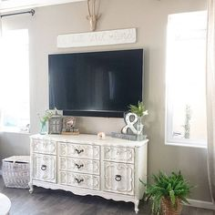 dresser to media stand makeover, dresser under tv, hide the tv cords, tv hung on wall, thrift store makeover, decorating on a budget, roadside junk