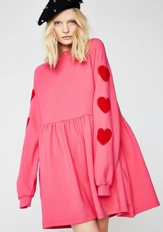 Lazy Oaf Velvet Heart Sweater Dress cuz you wear your heart on your sleeve. This pink sweater dress has a high neckline, red velvet hearts on the sleeves, and a loose N' flowy fit.