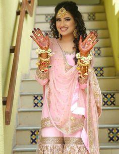 Mehendi Goals straight up! Gorgeous bride looking pretty Pc- .