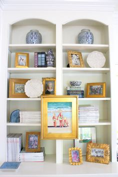 love to break up a bookcase with a picture hung over the shelves. This one isn't my fav. But I love doing this. It helps with the size balance and horizontal lines that are automatically created with bookcases.