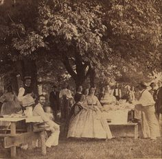 Independence Day picnic, 1862 by Thiophene_Guy, via Flickr.  Note the v-neckline and large hoop of the woman in the center