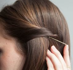 For no-show pins, point the bobby pin in the opposite direction of the hair you