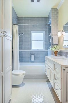 Gorgeous kohler bancroft in Bathroom Transitional with Gray Subway Tile next to Tile Around Window alongside Colored Subway Tile and Subway Tile Shower #traditionalbathroom