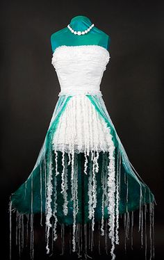 "Jellyfish Dress - ""The Jellyfish Dress (above) was created from used plastic bags. The skirt is made by ironing green dry cleaning bags together with blue newspaper bags. The necklace, bodice, skirt and the tentacles are made from white grocery bags."""