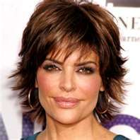 I went to the Salon today and took pictures of Lisa Rinna's Hairdo with me...and this is what I came home looking like! I also got it color ...