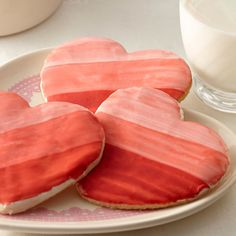 Make a quick and easy glaze for Valentine's Day cookies by warming canned white frosting in the microwave. Then paint ombre designs on the cookies using Flavor Paints - a fragrant mix of vanilla and food color.