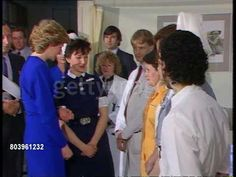 April 09, 1987: New AIDS ward/ Princess of Wales; England: London: Middlesex Hospital MS Princess Diana wearing knee length blue dress shakes staff in line MS Ward with two empty beds (patients refused to be filmed).