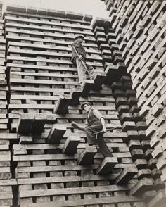"""Black and white, Old style, """"The photograph was taken in the Great Western Railway sleeper creosoting works in Hayes, Middlesex. The caption read 'sleepers are stacked and 'steps' left in this fashion so that the men can reach the top'. Vintage Pictures, Old Pictures, Old Photos, Train Pictures, Railway Sleepers, Stair Steps, Great Western, Stairway To Heaven, Big Tree"""