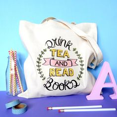 Drink Tea and Read Books Tote Bag:  Carry your favourite books with you where ever you go with this beautiful typographic tote bag.  Perfect for students, teachers, librarians and bibliophiles; this 100% natural cotton tote bag would make a wonderful gift for the book lover in your life (or as a little treat for yourself).  The bag is a lovely creamy oatmeal colour, with my own typographic design on the front. It measures approximately 43cm by 38cm, and has nice long handles to comfortably…