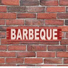 With the mere mention of the classic American cooking style invoked by the Barbeque Medium Tin Sign, with its look of rusty aging and bold, smoky hues, your guests' mouths will water in anticipation of deliciously savory grilled food! Made in the USA. Measures 20