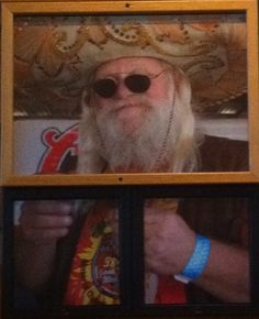 """Santa on vacation."""" On display at our local Chili's."""