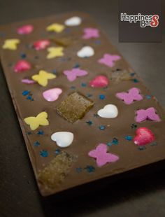 Milk chocolate happiness bar with butterflies,  strawberry drops, hearts and blue sprinkle stars!